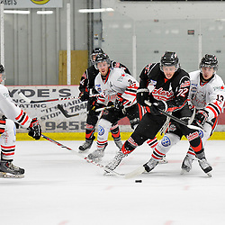 """FORT FRANCES, ON - May 2, 2015 : Central Canadian Junior """"A"""" Championship, game action between the Fort Frances Lakers and the Soo Thunderbirds, Championship game of the Dudley Hewitt Cup. Wyatt Cota #22 of the Fort Frances Lakers keeps the puck from Boris Katchouk #13 of the Soo Thunderbirds during the second period.<br /> (Photo by Shawn Muir / OJHL Images)"""