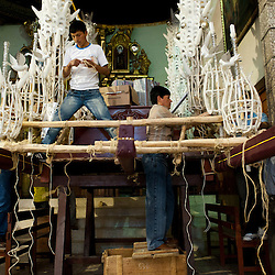 The Alarcon family builds a religious float for the Holy Week processions in Ayacucho, Peru. They carry on a tradition that has lasted five generations.