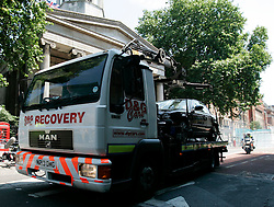 UK ENGLAND LONDON 10JUL05 - Recovery vehicles towing cars that stood at Tavistock Square leave Upper Woburn Place, near the bombed bus at Tavistock Square, central London.  At least 49 people have been killed and hundreds injured after four blasts on the Underground network and a double-decker bus in London...jre/Photo by Jiri Rezac ..© Jiri Rezac 2005..Contact: +44 (0) 7050 110 417.Mobile:  +44 (0) 7801 337 683.Office:  +44 (0) 20 8968 9635..Email:   jiri@jirirezac.com.Web:    www.jirirezac.com..© All images Jiri Rezac 2005 - All rights reserved.