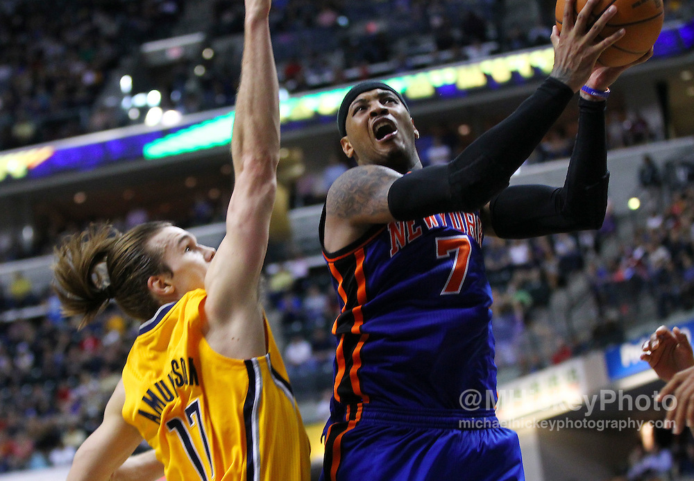 April 03, 2012; Indianapolis, IN, USA; New York Knicks small forward Carmelo Anthony (7) shoots the ball against Indiana Pacers center Louis Amundson (17) at Bankers Life Fieldhouse. Indiana defeated New York 112-104. Mandatory credit: Michael Hickey-US PRESSWIRE