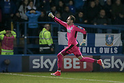 Huddersfield Town goalkeeper Danny Ward (1) runs the full length of the pitch to celebrate with the Huddersfield Town fans having saved Sheffield Wednesday's last penalty to put his side through to the final of the Championship play-offs during the EFL Sky Bet Championship play off second leg match between Sheffield Wednesday and Huddersfield Town at Hillsborough, Sheffield, England on 17 May 2017. Photo by Mark P Doherty.