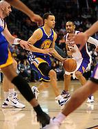 Feb. 10, 2011; Phoenix, AZ, USA; Golden State Warriors guard Stephen Curry (30) handles the ball against the Phoenix Suns at the US Airways Center. Mandatory Credit: Jennifer Stewart-US PRESSWIRE
