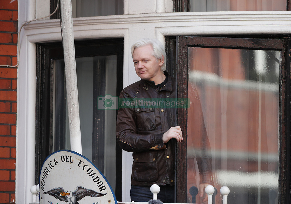 Julian Assange speaks from the balcony of the Ecuadorian embassy in London after a seven-year investigation in Sweden against the WikiLeaks founder was suddenly dropped.