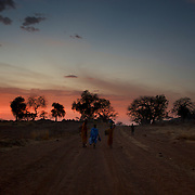 Local women walk along a road near the Nuba village of Tess in South Kordofan.