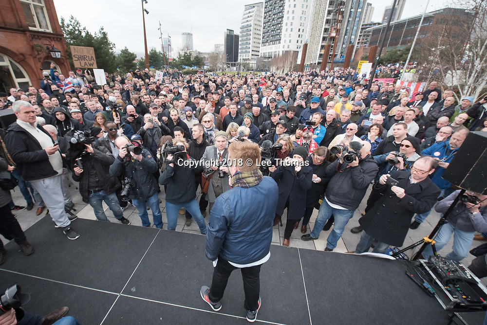 Birmingham, West Midlands, UK. 24th March 2018. Thousands of demonstrators converge on Birmingham city centre organised by three individual groups: Football Lads Alliance (FLA), Democratic Football Lads Alliance (DFLA) and Stand Up To Racism.  Pictured: John Meighan (blue jacket) - founder the FLA, addresses supporters at Millennium Point, Curzon Road. // Lee Thomas, Tel. 07784142973. Email: leepthomas@gmail.com  www.leept.co.uk (0000635435)