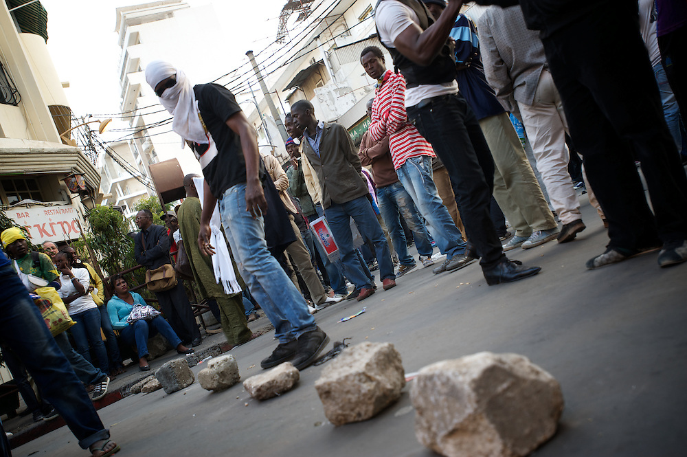 February 23, 2012 - Dakar, Senegal: A opposition supporter sets up a road block during a protest against the candidature of the current president Abdoulaye Wade for a anti-constitutional third candidature to as head of state. Tensions between police and opposition supporters have been high in the capital Dakar and other cities around the country, where some clashes have happen ahead of the presidential elections on the 26th of February. At least fourteen people have died in the past month. (Paulo Nunes dos Santos/Polaris)