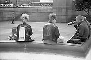 Punks, sitting at fountain, Trafalgar Square, London, 1980s