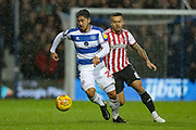QPR midfielder Massimo Luongo (21) and Brentford midfielder Nico Yennaris (8) during the EFL Sky Bet Championship match between Queens Park Rangers and Brentford at the Loftus Road Stadium, London, England on 10 November 2018.