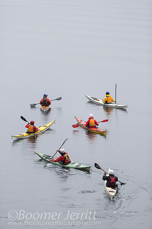 A group of Kayakers depart from Discovery Island Lodge for a day of exploration paddling waters around the Discovery Islands.  Quadra Island, Discovery Islands, British Columbia, Canada