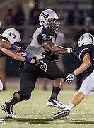 Hendrickson running back Samaje Perine stiff arms Cedar Ridge's Cameron Welmann Friday night at Dragon Stadium.  The Hawks beat the Raiders 35-28.