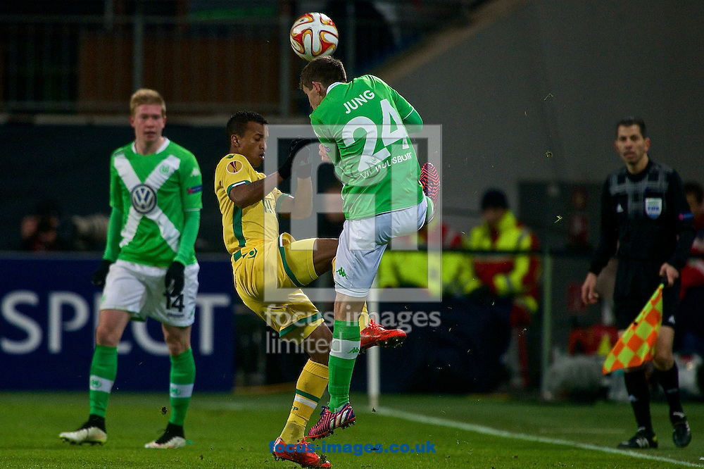 Nani of Sporting Clube de Portugal (left) and Sebastian Jung of VfL Wolfsburg during the UEFA Europa League match at Volkswagen Arena, Wolfsburg<br /> Picture by Ian Wadkins/Focus Images Ltd +44 7877 568959<br /> 19/02/2015