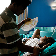 Milan, Italy, August, 2008. Tasmi, 28, from Sri Lanka gives birth to her second baby. Her partner Rawil is beside her.