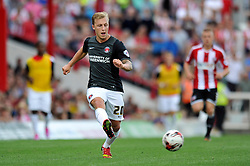 Charlton Athletic's Chris Solly passes the ball - Photo mandatory by-line: Patrick Khachfe/JMP - Mobile: 07966 386802 09/08/2014 - SPORT - FOOTBALL - Brentford - Griffin Park - Brentford v Charlton Athletic - Sky Bet Championship - First game of the season