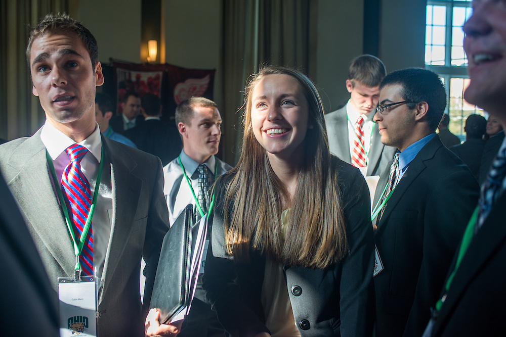Colin Merz, left, and Carrie Barchers, right chat with fellow students during the Ohio University Sports Administration Career Fair. Photo by Elizabeth Held