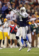 IRVING, TX - NOVEMBER 29: Cornerback Terence Newman #41 of the Dallas Cowboys celebrates after intercepting a pass in the second quarter of the game against the Green Bay Packers on November 29, 2007 at Texas Stadium in Irving, Texas. The Cowboys defeated the Packers 37-27. ©Paul Anthony Spinelli *** Local Caption *** Terence Newman