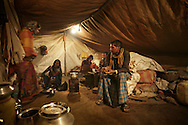 Sampan Das, right, and his family cook in the tent in Dhanbad, Jharkhand, India, on Dec 5, 2014. Forty five houses, including Das' in Angarpathra village collapsed as the earth caved in due to an underground coal fire on Nov 14. The government provided people who lost their homes about $200 but those who don't have money to re-build their houses live in tents.<br /> (Photo by Kuni Takahashi)