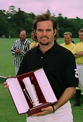 Top polo player EDUARDO HEGUY at a polo match in Cirencester on 24th June 1997.LZP 66