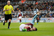 Kevin Long of Burnley lies injured on the pitch during the Barclays Premier League match at St. James's Park, Newcastle<br /> Picture by Simon Moore/Focus Images Ltd 07807 671782<br /> 01/01/2015