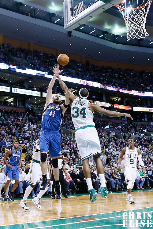 05 December 2012: Minnesota Timberwolves power forward Kevin Love (42) goes for the skyhook over Boston Celtics small forward Paul Pierce (34) during the Boston Celtics 104-94 victory over the Minnesota Timberwolves at the TD Garden, Boston, Massachusetts, USA.