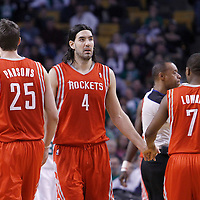 06 March 2012: Houston Rockets power forward Luis Scola (4) is congratulated by Houston Rockets point guard Kyle Lowry (7) and Houston Rockets forward Chandler Parsons (25) during the Boston Celtics 97-92 (OT) victory over the Houston Rockets at the TD Garden, Boston, Massachusetts, USA.