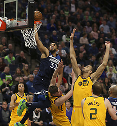 April 1, 2018 - Minneapolis, MN, USA - Minnesota Timberwolves center Karl-Anthony Towns (32) is fouled by Utah Jazz forward Jonas Jerebko (8) as he shoots in the first half on Sunday, April 1, 2018 at Target Center in Minneapolis, Minn. (Credit Image: © Jeff Wheeler/TNS via ZUMA Wire)