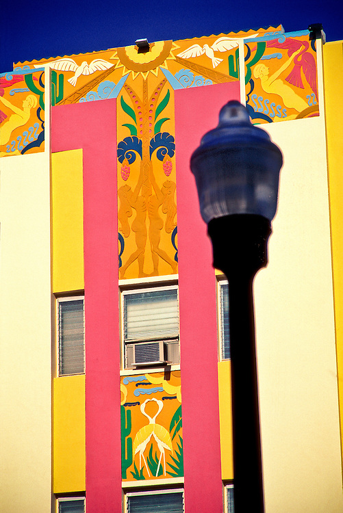 Art Deco bas-reliefs of nudes, birds and a tropical sun adorn the facade of a small Miami Beach hotel at 444 Ocean Drive. Designed by architect Henry Hohauser in 1936, it's a superb example of the flamboyant Tropical Deco style for which Miami's historic South Beach neighborhood is world-renowned.