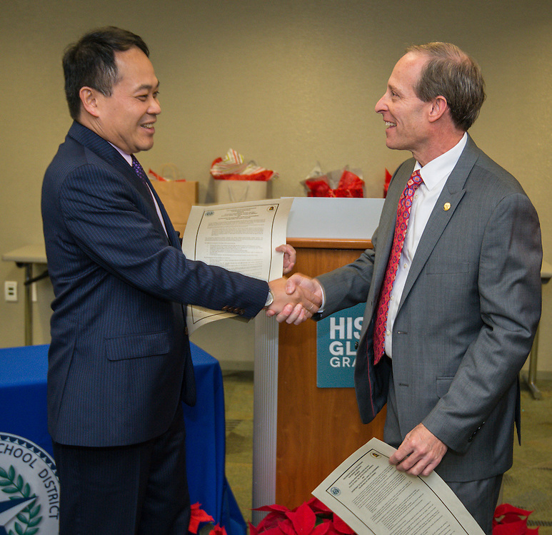 Houston ISD trustee Greg Meyers, right, and Director General Louis M. Huang, left, of the Taipei Economic and Cultural Office in Houston, shake hands after signing a partnership agreement during a ceremony, December 17, 2015.