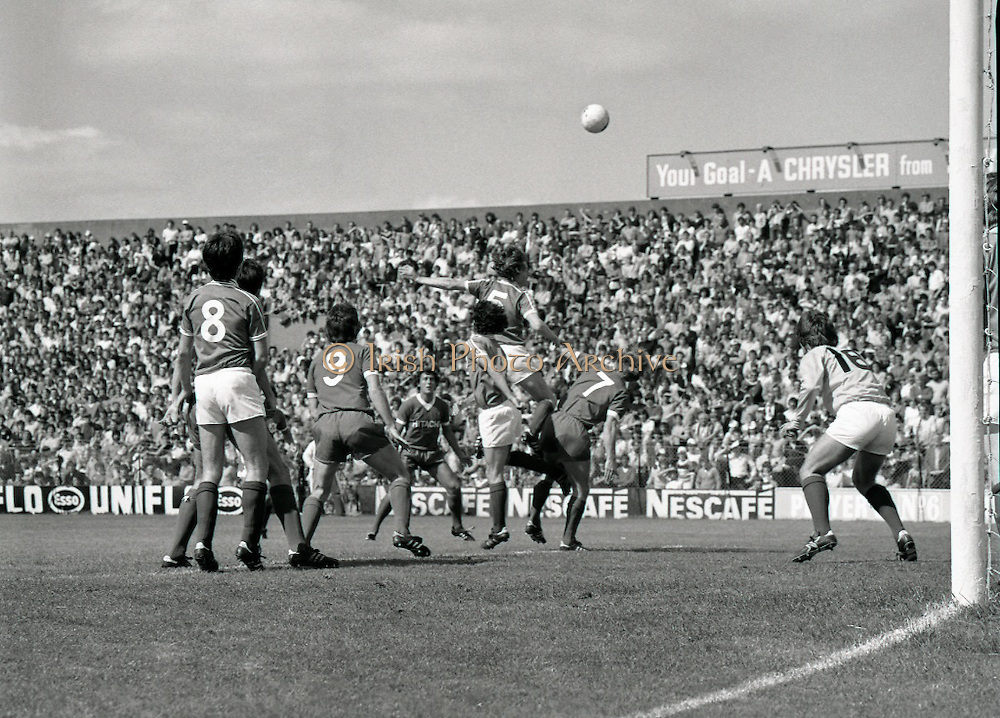 League of Ireland vs Liverpool FC.    (M87)..1979..18.08.1979..08.18.1979..18th August !979..In a pre season friendly the League of Ireland took on Liverpool FC at Dalymount Park Phibsborough,Dublin. The league team was made up of a selection of players from several League of Ireland clubs and was captained by the legendary John Giles. Liverpool won the game by 2 goals to nil..The scorers were Hansen and McDermott...Image shows Noel Synnott (5) heading clear despite the attentions of Kenny Dalglish (7). also in the picture are Cathal Muckian (8), David Johnson (9),John McCormack (4),goalkeeper Alan O'Neill and Ray Kennedy.