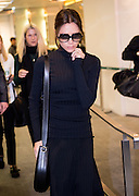 Victoria Beckham leaves the press conference for her store held in Duddells restaurant Hong Kong