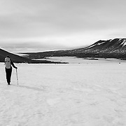Trekking across the surface of the Canada Glacier. Lake Fryxell, Kukri Hills and the tip of the Commonwealth Glacier in the distance.