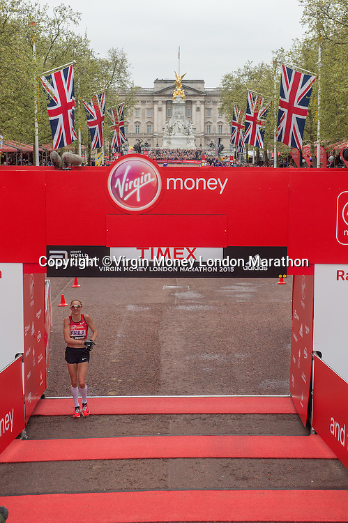 Great Britain's Paula Radcliffe crosses the line on The Mall to complete her final marathon at the Virgin Money  London Marathon, Sunday 26th April 2015.<br /> <br /> Dillon Bryden for Virgin Money London Marathon<br /> <br /> For more information please contact Penny Dain at pennyd@london-marathon.co.uk