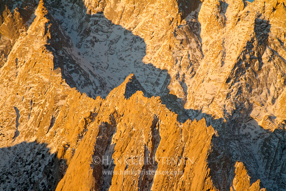 Snow, rock, shadow and light combine to illustrate the steep slopes of Lone Pine Peak at dawn