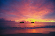 Mokulua Islands at sunrise from Lanikai Beach, Kailua, Windward Oahu, Hawaii.