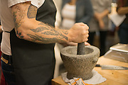 Ricker shows class how to use a mortar and pestle
