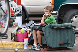 Aaron Mamer patiently sits outside of Mc Elroy dorms watching his sister's belongings as she moves into her new dorm room her freshmen year