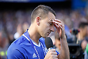 Chelsea Defender John Terry (26) holds back tears while giving his speech during the Premier League match between Chelsea and Sunderland at Stamford Bridge, London, England on 21 May 2017. Photo by Andy Walter.
