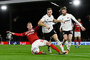 George Saville (22) of Middlesbrough goes down under the challenge of Kevin McDonald (6) of Fulham during the EFL Sky Bet Championship match between Fulham and Middlesbrough at Craven Cottage, London, England on 17 January 2020.
