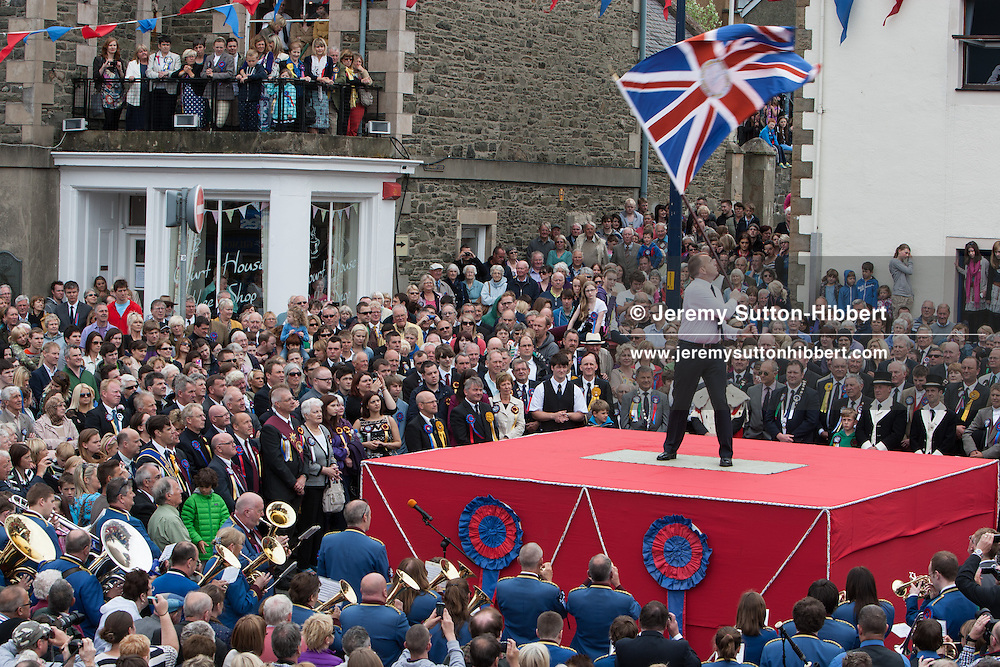 David Deacon, is the Ex-Soldiers Standard Bearer, waving a Union Jack standard flag, during The Casting of the Colours ceremony, where the town's associations flags are waved in spectacular fashion in front of large crowds, in Selkirk, Scotland, Friday 14th June 2013.