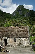 Philippines, Batanes. Traditional Ivatan houses in Chavayan, a small village situated on Sabtang Island. Ivatans are the inhabitants od Batanes Islands.