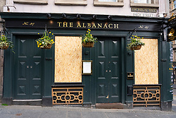 Edinburgh, Scotland, UK. 29 March, 2020. Life in Edinburgh on the first Sunday of the Coronavirus lockdown. Streets deserted, shops and restaurants closed, very little traffic on streets and reduced public transport. Pictured; The Albanach Pub is closed and boarded up. Iain Masterton/Alamy Live News