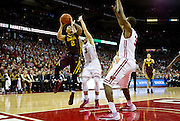Guard Nate Mason (2) goes for a shot during the second half of the University of Minnesota Men's Basketball game versus University of Wisconsin on March 5, 2017.