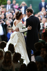 Princess Eugenie and her new husband Jack Brooksbank kiss as they leave St George's Chapel in Windsor Castle following their wedding.