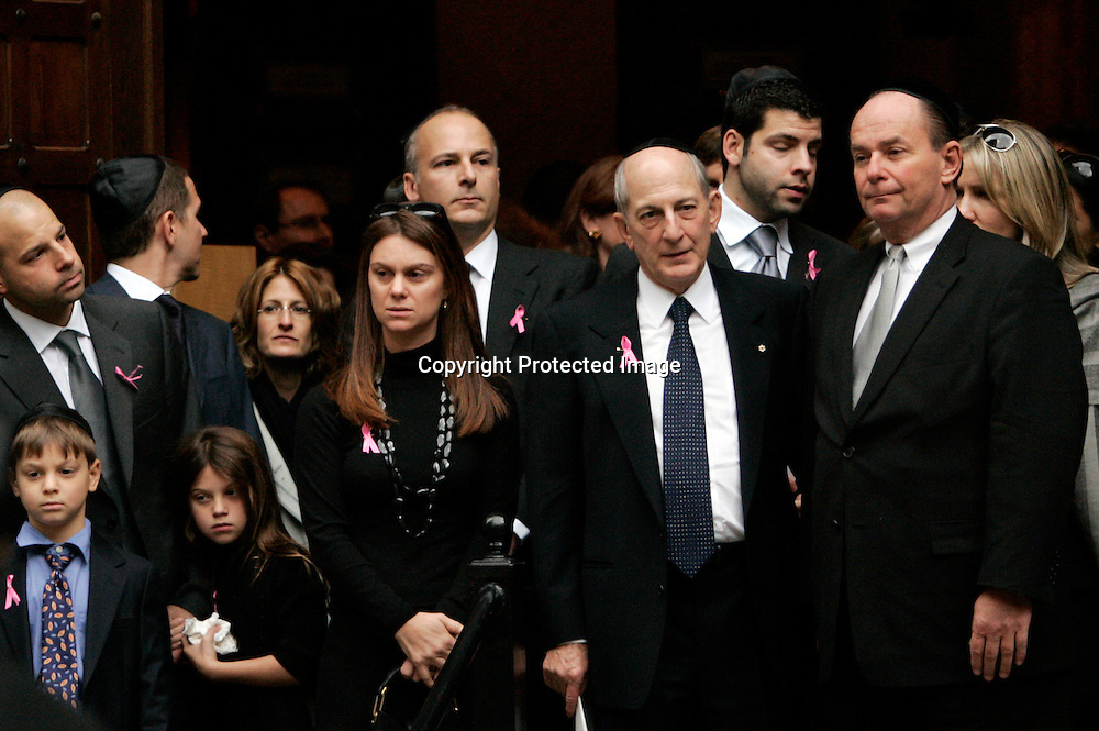 Mourners gather after memorial services for Andrea Bronfman at the B'nai Jeshurun synagogue in New York January 25, 2006. Bronfman, wife of Charles Bronfman, heir to the Canadian Seagram's liquor empire, was struck and killed by a car on Monday. Photo by Keith Bedford