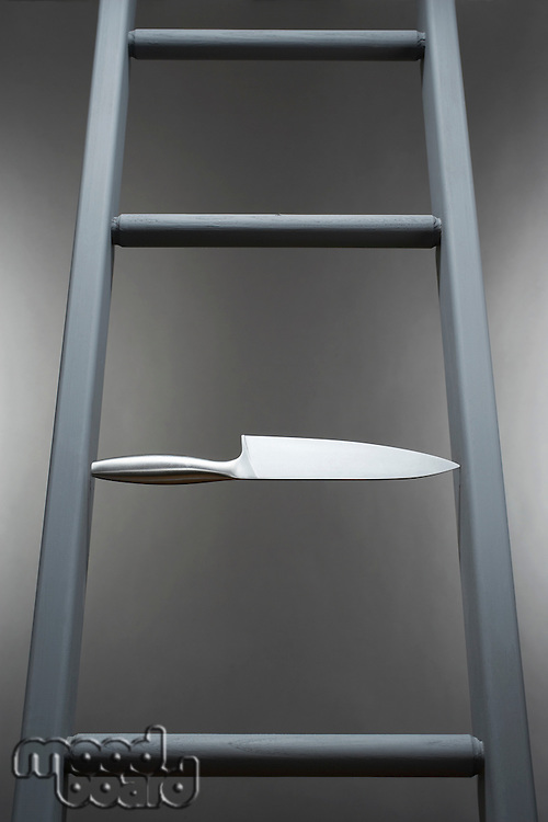 Kitchen knife in place of step in ladder