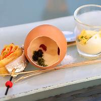 Amuse-bouche of egg dishes at the Relais & Chateaux La Cote Saint-Jacques.