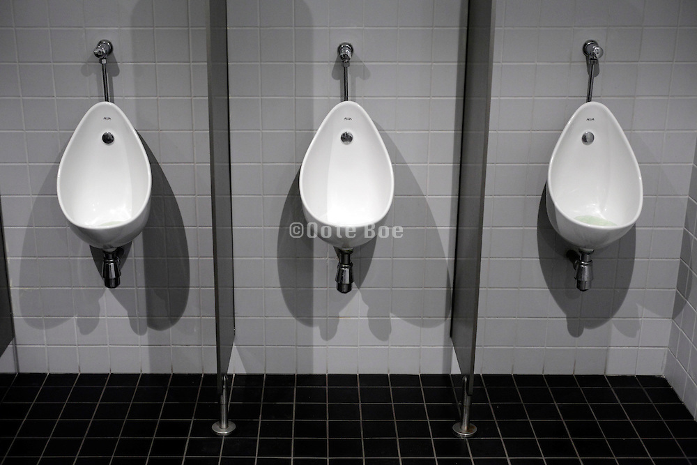 clean white urinals in a public toilet