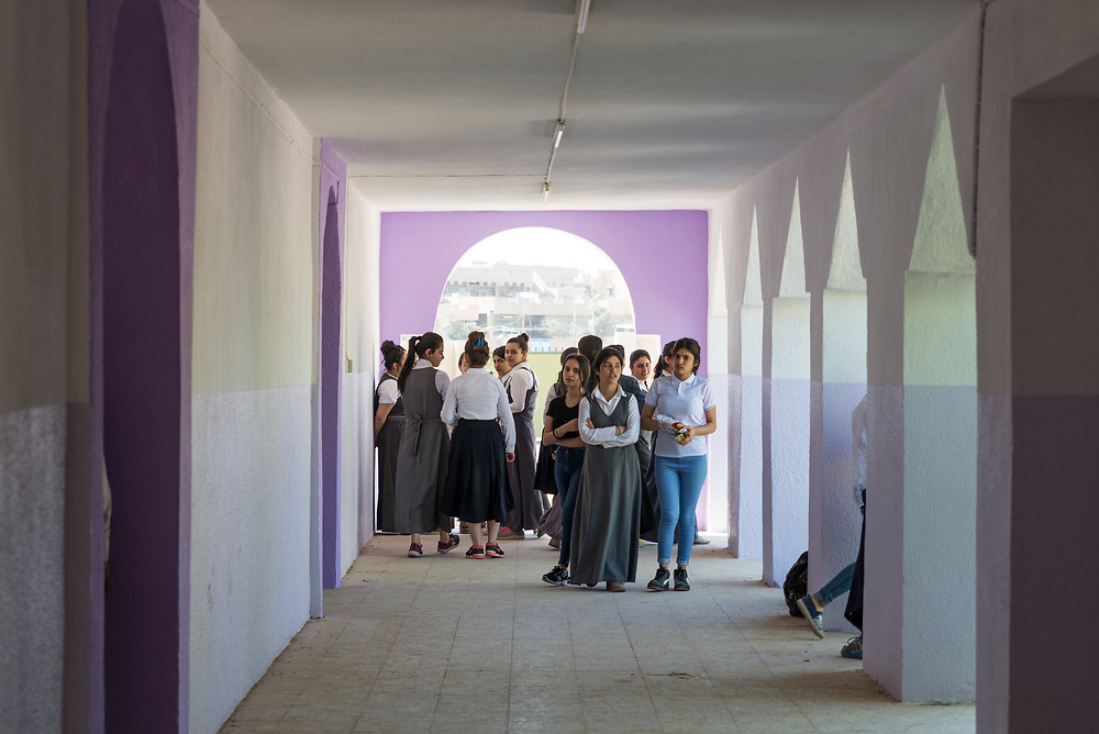 11 October 2017 &ndash; Ninewa Plains &ndash; Iraq &ndash; Pupils walk to class at the Mareem al Adhraa High School in the Hamdaniyah Sub District. <br /> <br /> UNDP&rsquo;s Funding Facility for Stabilization is helping rehabilitate the school, which re-opened on October 7, 2017. &ldquo;All of us are happy,&rdquo; said Amal Azzu Petros, the Principal of the Secondary School. <br /> <br /> &copy; UNDP Iraq / Claire Thomas