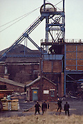 Police playing cricket under the headgear at Dodworth pit during the 1984-85 Miners Strike. Feb 1985.
