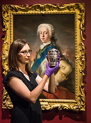 """The National Museum of Scotland in Edinburgh hosts a new exhibition """"Bonnie Prince Charlie and the Jacobites"""" from 23 June to 12 November 2017.<br /> <br /> The exhibition explores the lives of the Jacobites in exile first in France and later in Rome and features over 300 objects from 44 lenders across Scotland, UK and Europe.<br /> <br /> Pictured: An ornate travelling canteen owned by Bonnie Prince Charlie held by Assistant Curator Adrienne Hynes"""