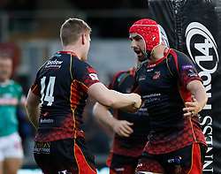 Dragons' Dafydd Howells celebrates scoring his sides first try with team-mate Cory Hill<br /> <br /> Photographer Simon King/Replay Images<br /> <br /> Guinness PRO14 Round 1 - Dragons v Benetton Treviso - Saturday 1st September 2018 - Rodney Parade - Newport<br /> <br /> World Copyright © Replay Images . All rights reserved. info@replayimages.co.uk - http://replayimages.co.uk